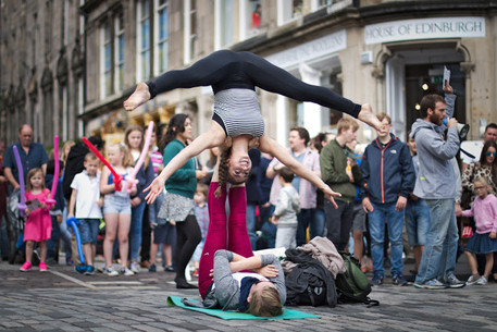 Cynthia Price basing Taylor Casas while street performing along the Royal Mile in Edinburgh, Scotland.