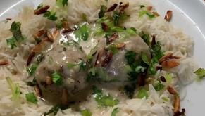 Iraqi Kuba Burghul (cracked wheat) with yogurt SauceIraqi Kuba Burghul stuffed with ground beef.