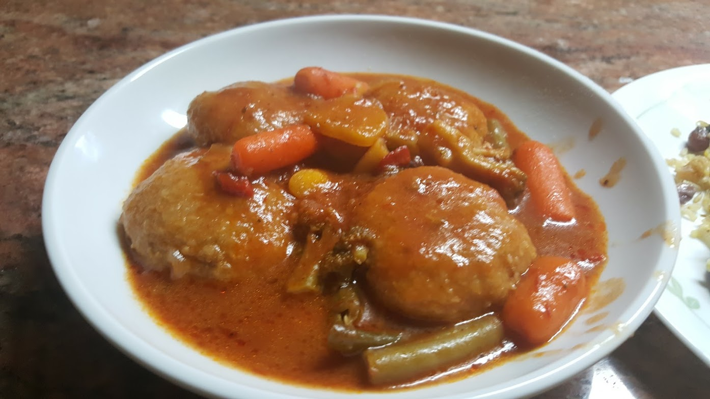 Burghul Dumplings with Tomato sauce