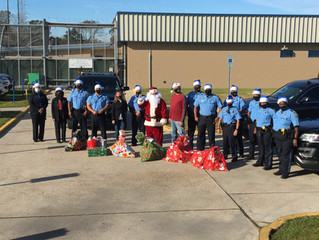 GSmith, officers & community partners deliver Christmas gifts