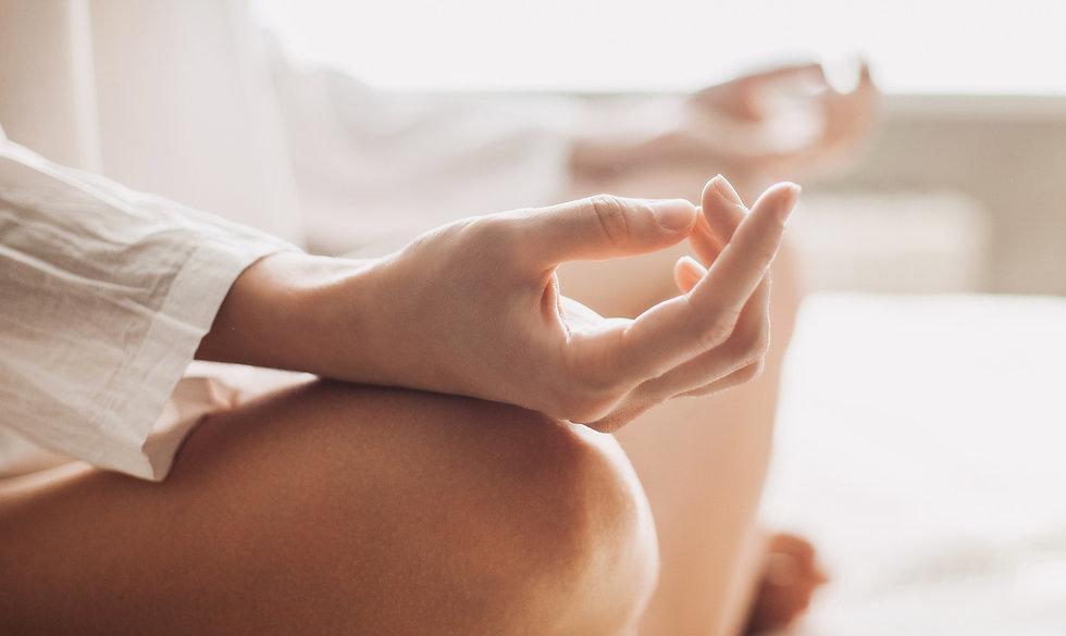 Woman's meditating hands