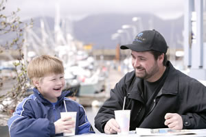 Aleutia President Danny Cumberlidge and son Evan visit outside Sand Point's Harbor Cafe. Father and son both fish.