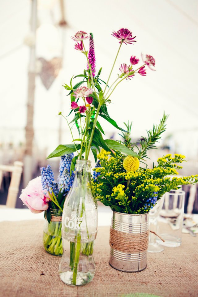 Cluster of vases on long table