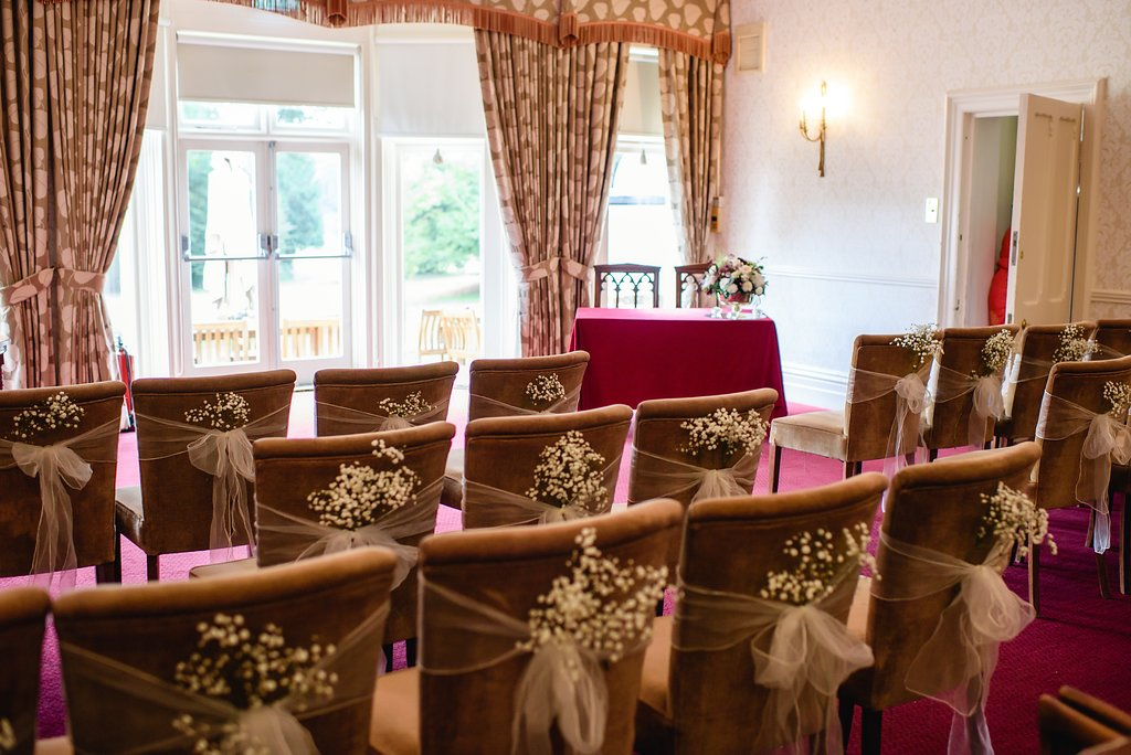 Flit wick Manor ceremony flower pew
