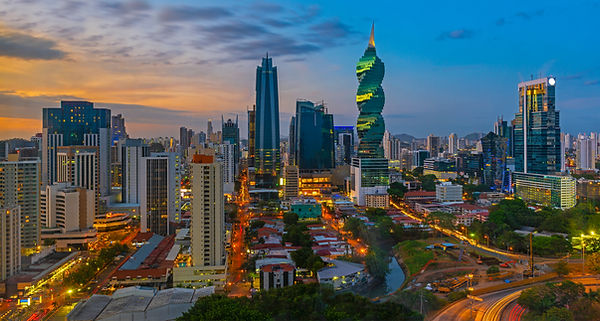 The colorful panoramic skyline of Panama City at sunset with high rise skyscrapers, Panama