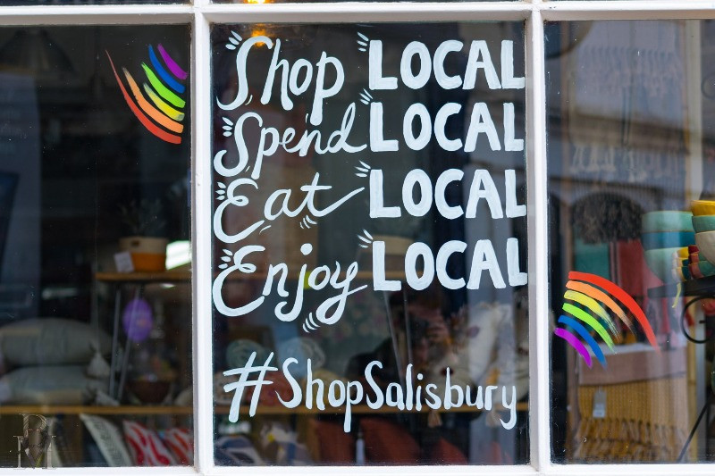 A shop window saying to shop local, spend local, eat local and enjoy local. #shop salisbury