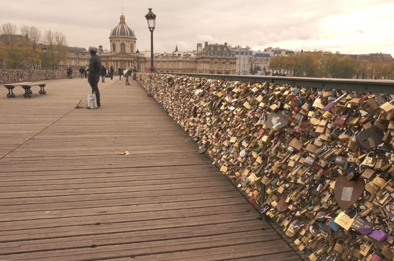 Thousands of padlocks attached to the Pont des Artes in Paris