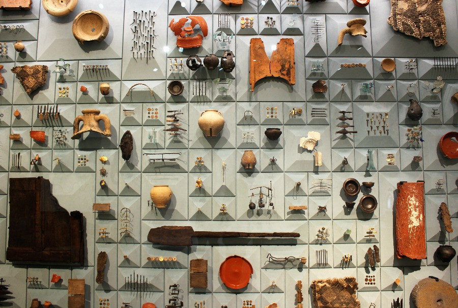 A wall with artefacts attached to it