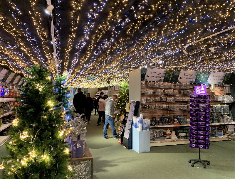 A shop with thousands of fairy lights across the ceiling.