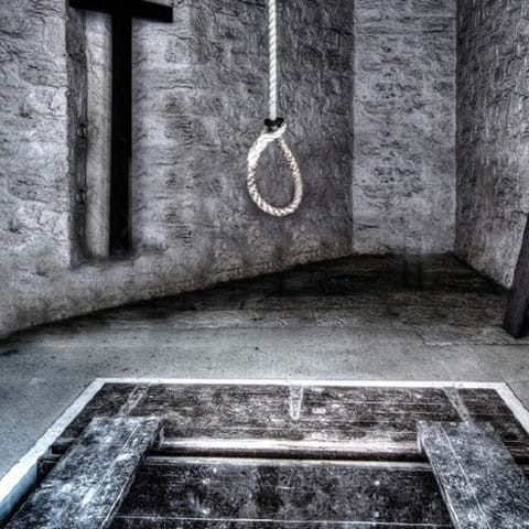 A noose hanging over a hole in the floor