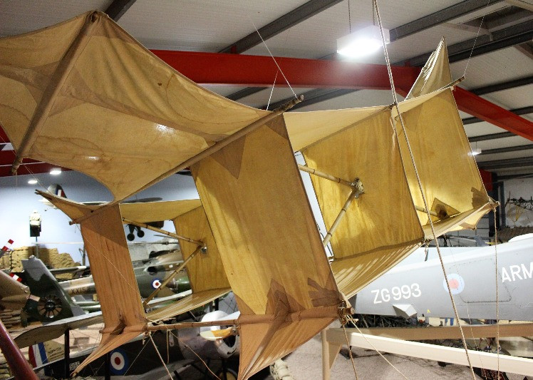 A Cody kite hanging from the ceiling in the flying museum.