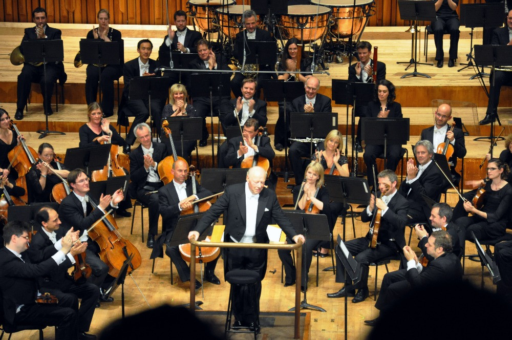 The orchestra and conductor of the LSO at the end of a performance.