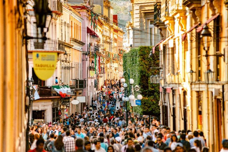 Huge crowds of people in a street in Spain.