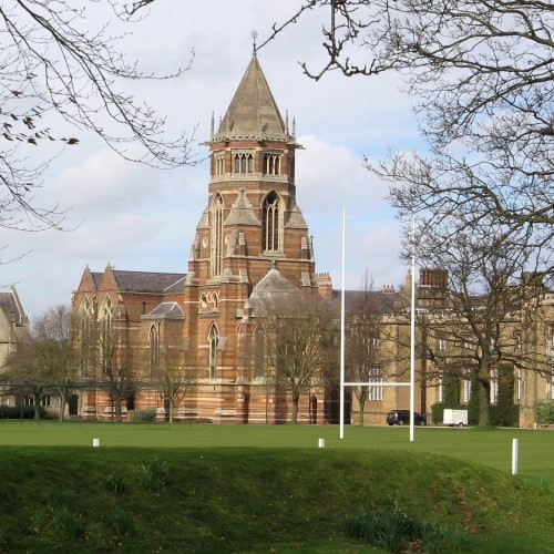 The outsid eof Rugby School showing the rugby pitch.