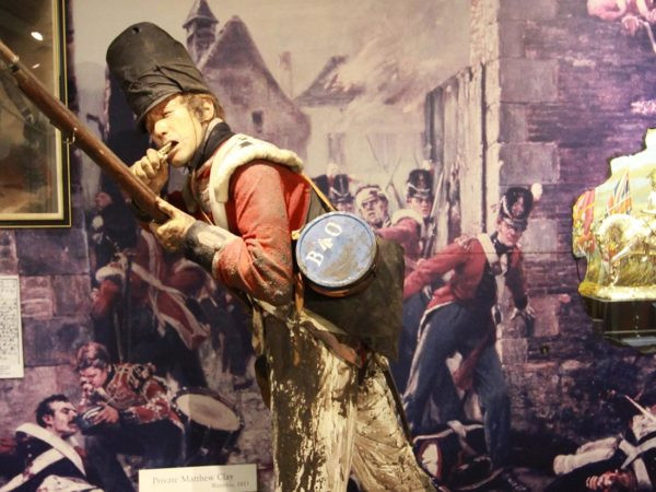 A display inside the Guards museum of Matthew Clay about to fire his rifle.