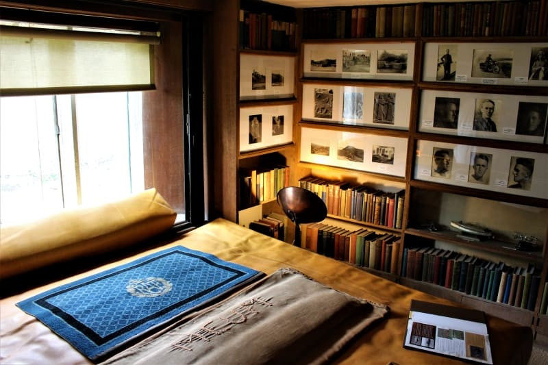 The divan and bookshelves in Lawrence's book room.