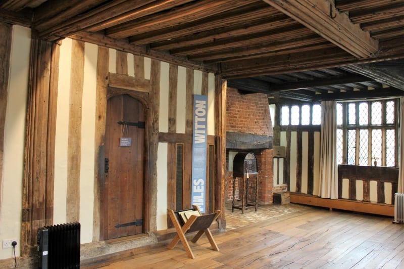 The main hall inside the Guildhall showing wooden floorboards and walls.