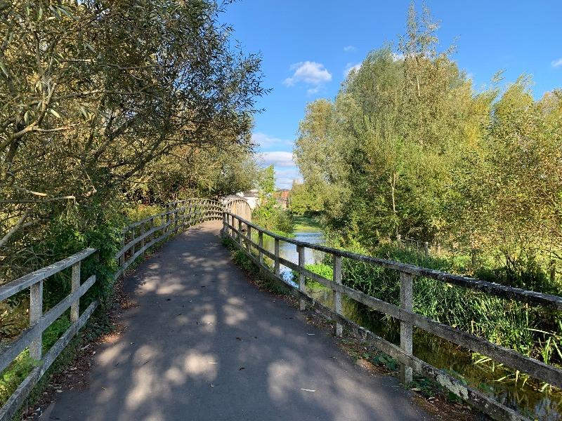 A bridge over the Town Path leading to Queen Elizabeth Gardens in Salisbury