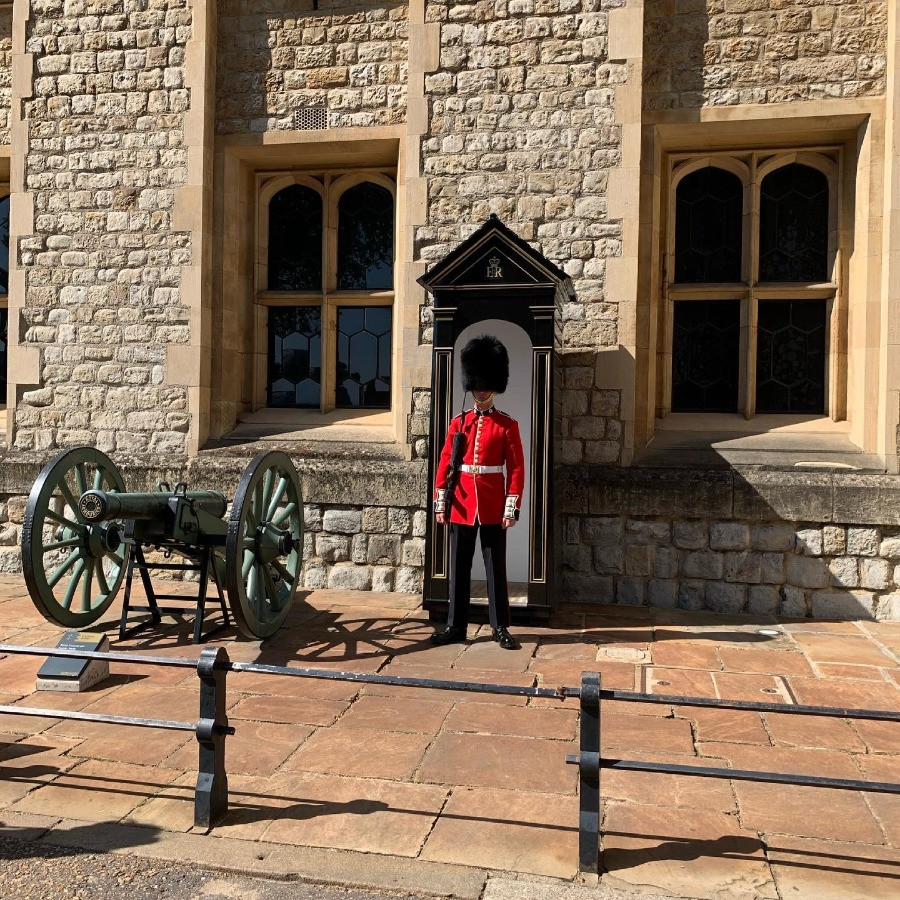 A Beefeater standing to attention