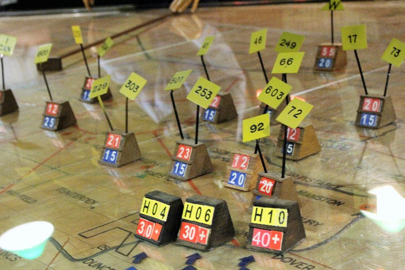 A close up of the wooden blocks used on the plotting map
