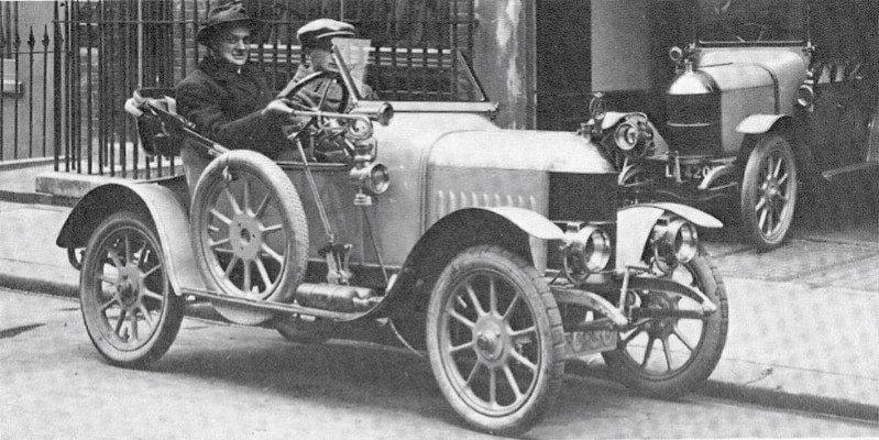 A black and white photo of William Morris driving one of his cars