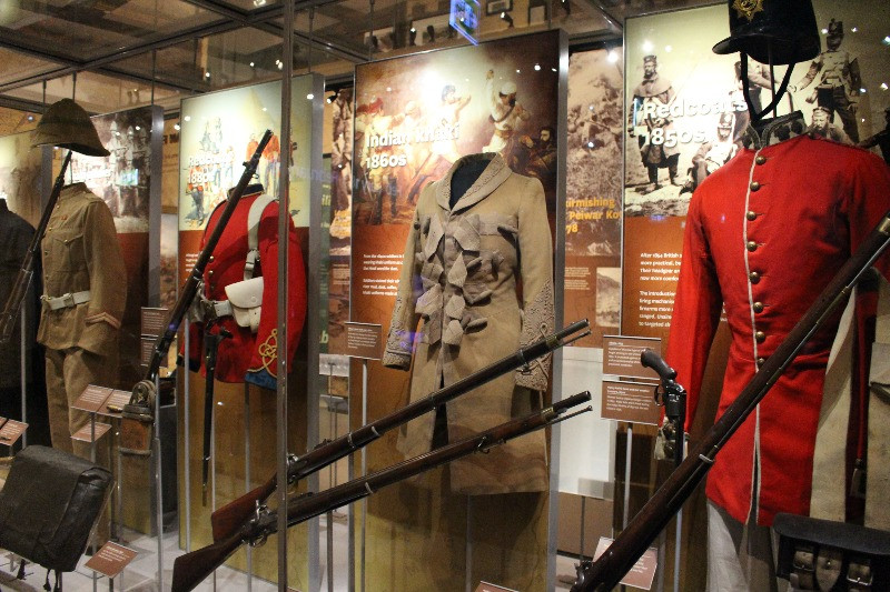 A variety of military uniforms i a display cabinet at the National Army Museum in Chelsea.