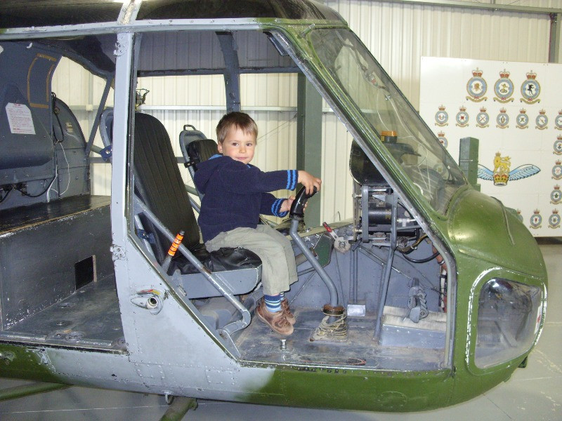 A toddler sitting in a helicopter