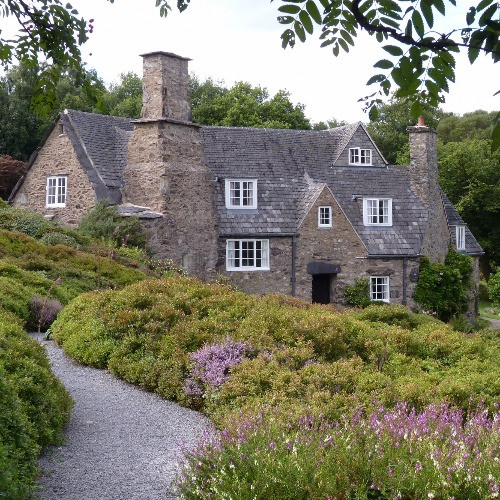 Stoneywell House in the Arts and Crafts style set in beautiful gardens.