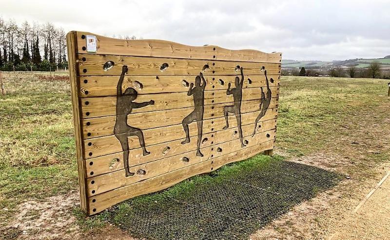A small wooden climbing wall