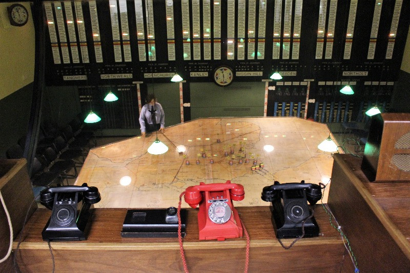 The commanders view over the plotting table with a row of telephones in front of him