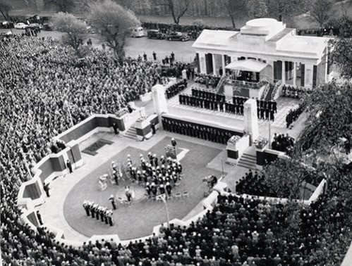 A black and white photo of the crowds around the memorial at the opeing