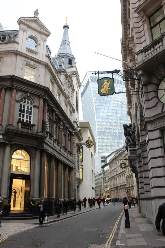 The signs of Lombard Street today with the walkie-talkie sky scraper behind them.