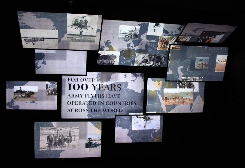 Several welcome screens showing footage of army flying