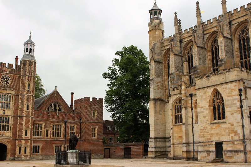 The courtyard at Eton school showing the chapel and statue of the King.