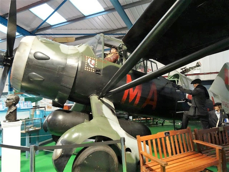 A mannequin sitting in a World War I plane