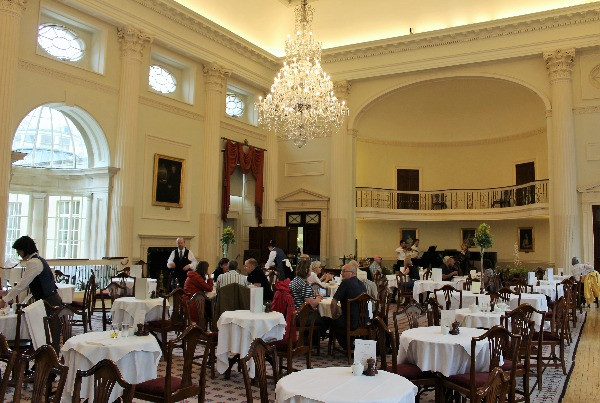 Inside the Pump Rooms at Bath where people are dining.