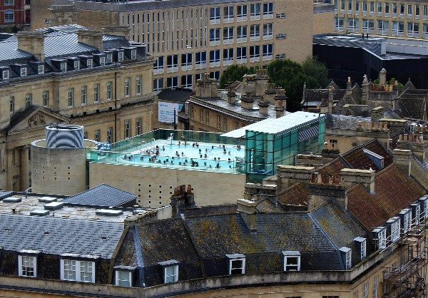 The outdoor thermae bath spa on top of a building in the skyline.