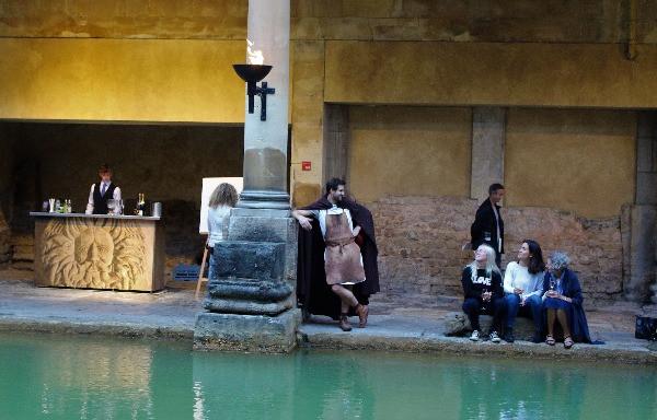 people sitting around the edge of the main bath.