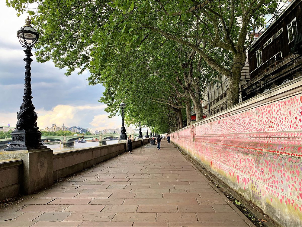 The Memorial wall next to the river