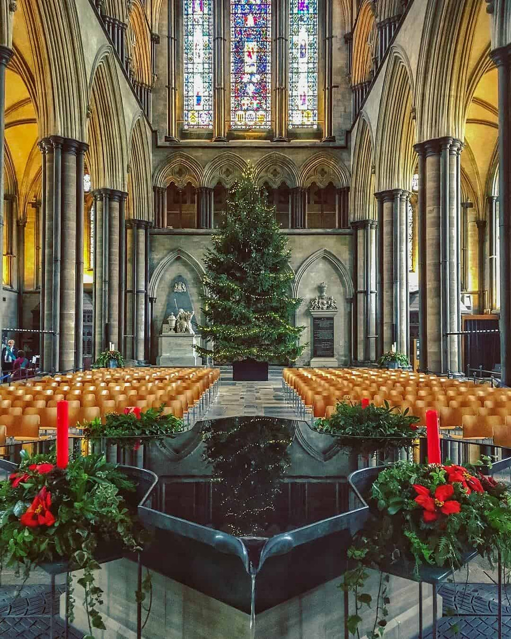 The font in Salisbury Cathedral with a Christmas tree behind it.