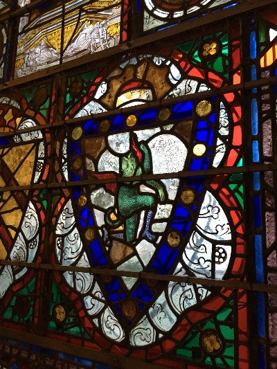 A close up of a medieval stained glass window.