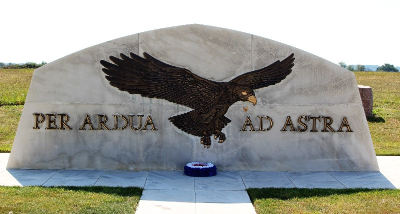 A stone memorial with an eagle painted on it