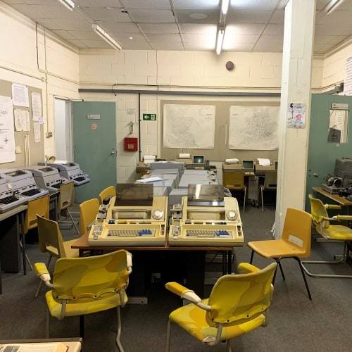 Chairs and old computers in Kelvedon Hatch Nuclear Bunker