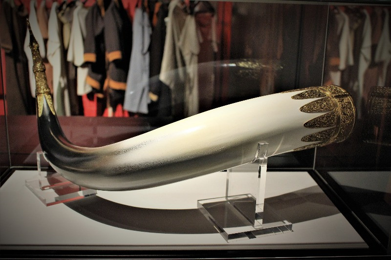 A replica large white drinking horn