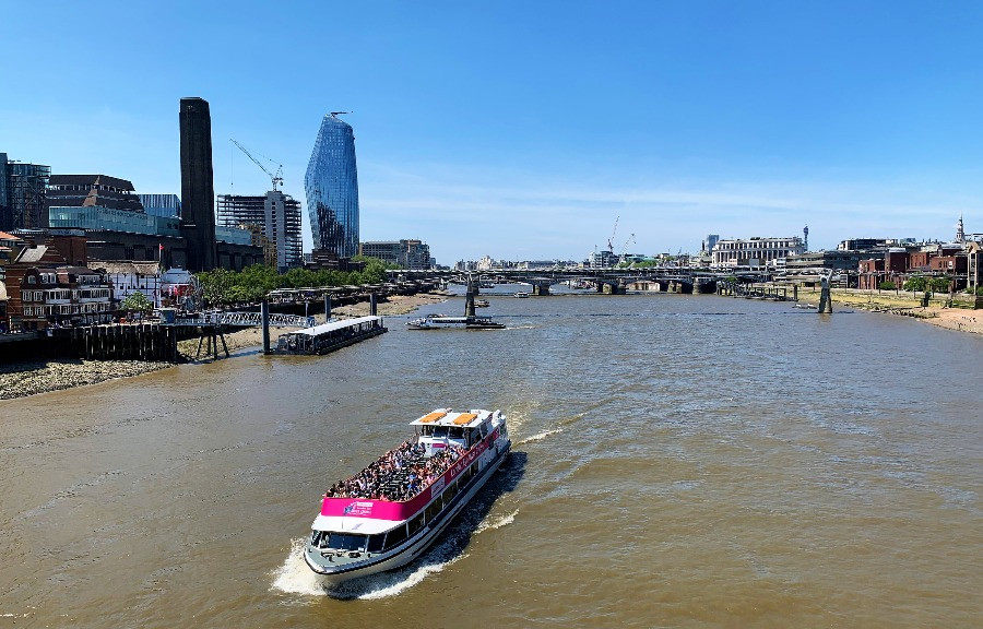 A boat sailing down the Thames