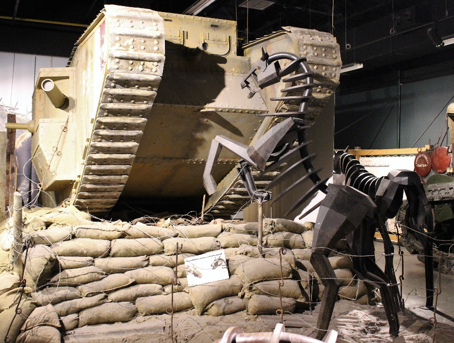 A metal horse rearing under a tank