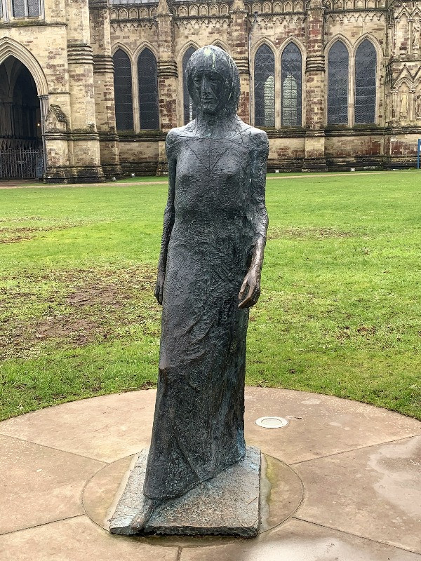 The statue of the Walking Madonna outside Salisbury Cathedral