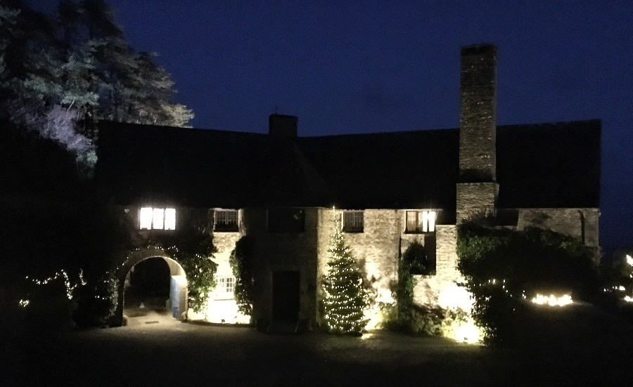 The outisde of the house lit up at night