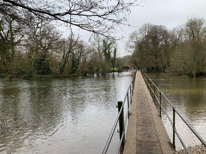 A arrow bridge over a river