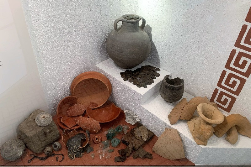 Urns filled with coins